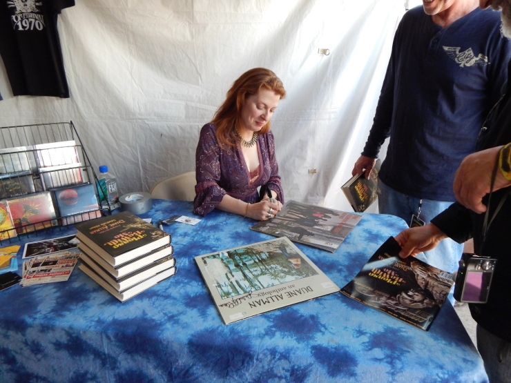 Galadrielle Allman signing books and other objects after her book discussion.